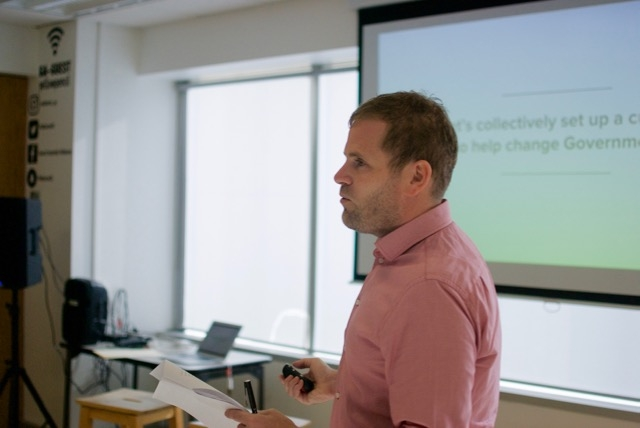 Photo of Simon Goodrich presenting at the event