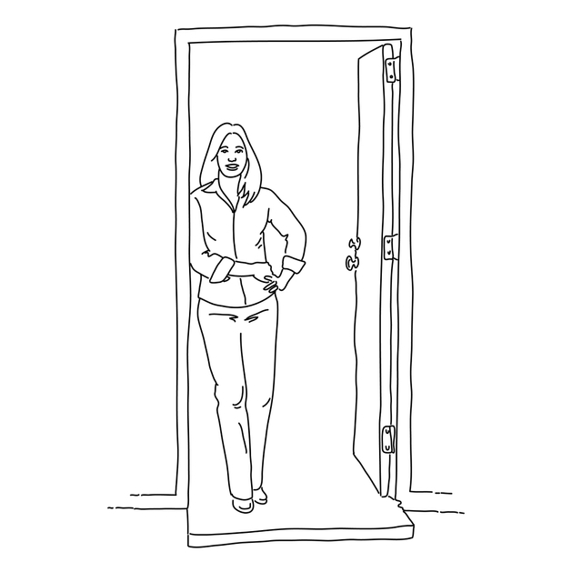Woman smiling while standing in a doorway